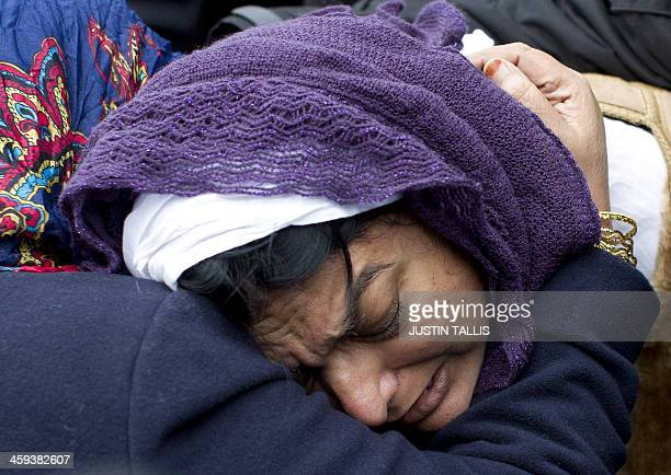 Fatima Khan the mother of Abbas Khan the British doctor who died in a Syrian jail is comforted after prayers at Regents Park Mosque in central London...