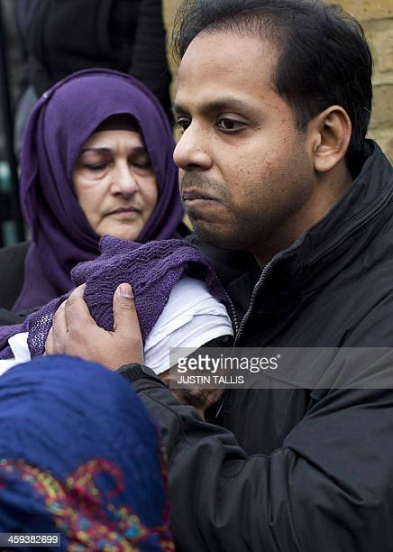 Fatima Khan the mother of Abbas Khan the British doctor who died in a Syrian jail is comforted by her son Afroze Khan after prayers at Regents Park...
