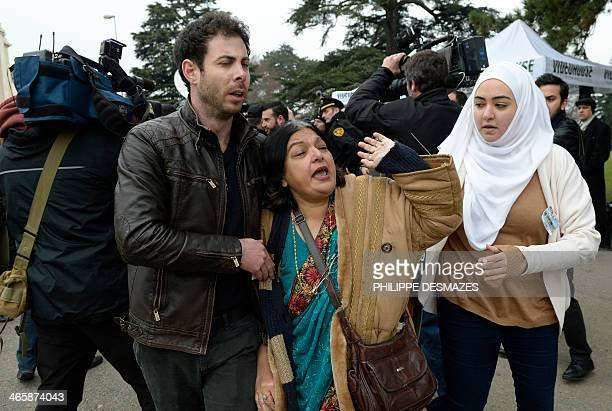 Fatima Khan the mother of British doctor Abbas Khan who died at 32 in a Syrian jail in disputed circumstances is escorted away by friends after...