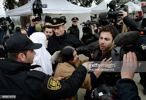 Fatima Khan the mother of British doctor Abbas Khan who died at 32 in a Syrian jail in disputed circumstances is escorted away by United Nations...