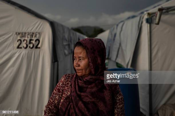 Fatima Lumabao standing in front of tent shelters on May 14 2018 in Marawi Philippines Mrs Lumabao lost four children during their escape from inside...