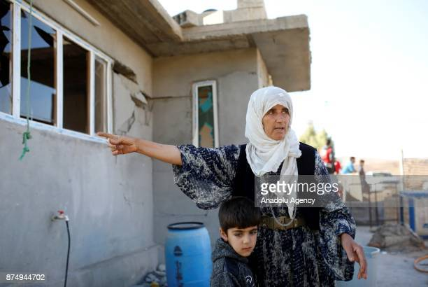 Fatima Mohamed Karim shows a damaged house during an interview at the quakehit area in Karavuta village of Derbendihan district in Sulaymaniyah Iraq...