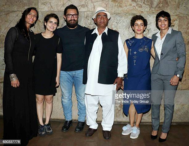 Fatima Sana Shaikh Aamir Khan Wrestler Mahavir Singh Phogat actor Sanya Malhotra and Wrestler Babita Kumari during the special screening of film...