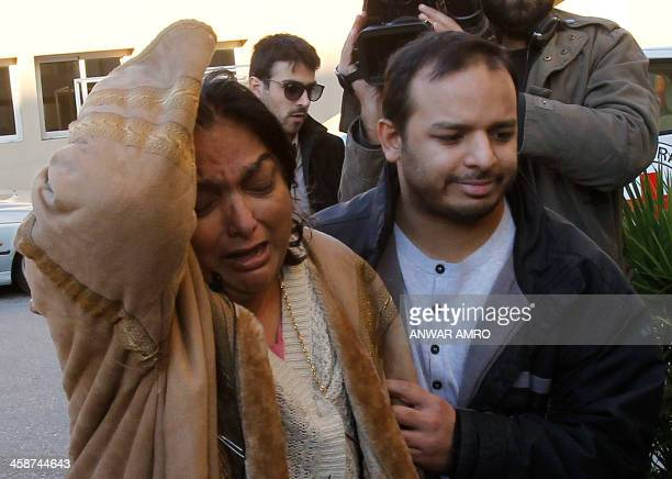 Fatima the mother of Abbas Khan the British doctor who died in a Syrian jail grieves with Abbas' brother outside the Hotel Dieu hospital in Beirut...