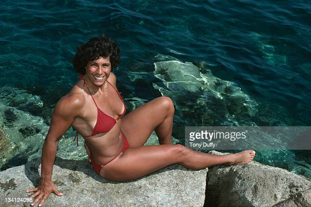 Fatima Whitbread of Great Britain relaxes in a bikini by the sea during training on 10th March 1983 in Limassol Cyprus