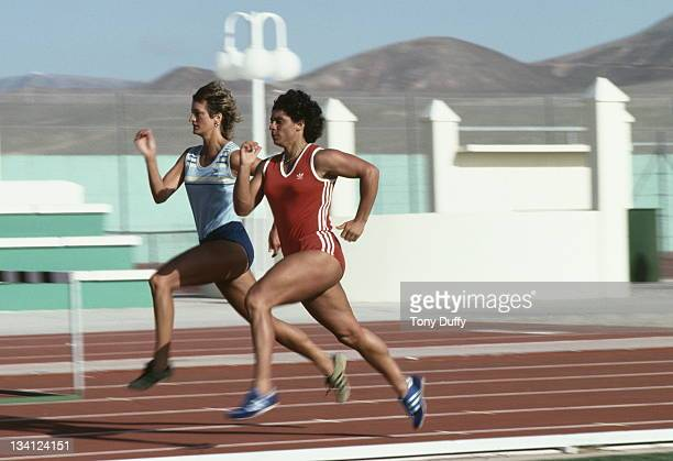 Fatima Whitbread of Great Britain runs with Donna Hartley during training on 1st February 1984 at the British Olympic training camp in La Santa...