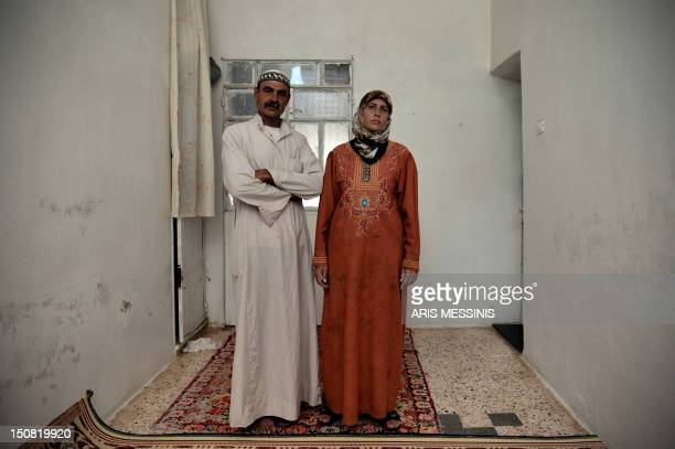 Fatima Zahra and her husband Ahmed pose for a picture at their house outside the northern city of Aleppo on August 26, 2012. When the Syrian uprising...