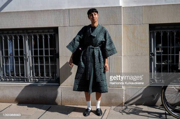 Fatimah Gabriella outside MFPEN wearing dark green coat with belt white socks and black shoes during Copenhagen fashion week SS21 on August 12 2020...