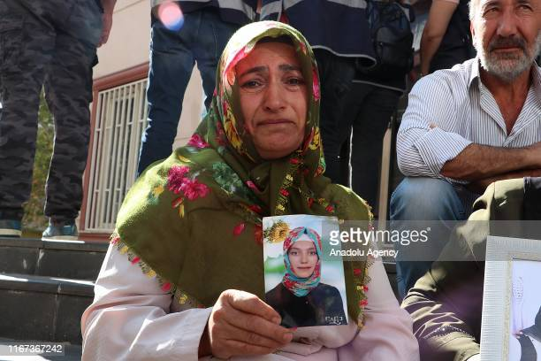 Fatma Akkus, who lost her daughter to the hands of the terror group, holds her daughter Songul Akkus' photograph as she joins a sit-in protest in...