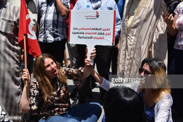 Fatma Mseddi shouting slogans during the demonstration. A sit-in demonstration demanding the rapid election and dissolution of Parliament and the...