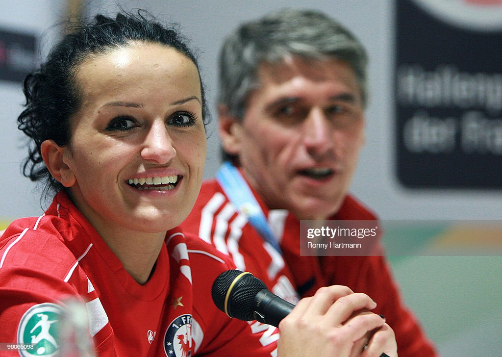 Fatmire Bajmaraj (L) of 1. FFC Turbine Potsdam and head coach Guenther Woerle of Bayern Muenchen are seen after the T-Home DFB Indoor Cup at the Boerdelandhalle on January 23, 2010 in Magdeburg, Germany.