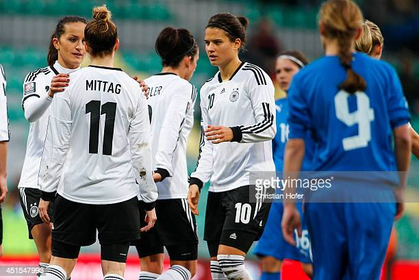 Fatmire Bajramaj, Anja Mittag and Dzsenifer Maroszan of Germany celebrate after scoring during the FIFA Women's World Cup 2015 Qualifier between...
