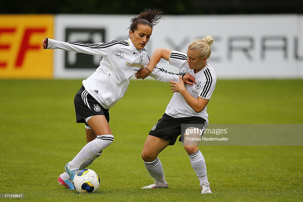 Fatmire Bajramaj competes for the ball with Leonie Maier (R) during the German women's national team training session at HVB Club Sportzentrum on June 24, 2013 in Munich, Germany.