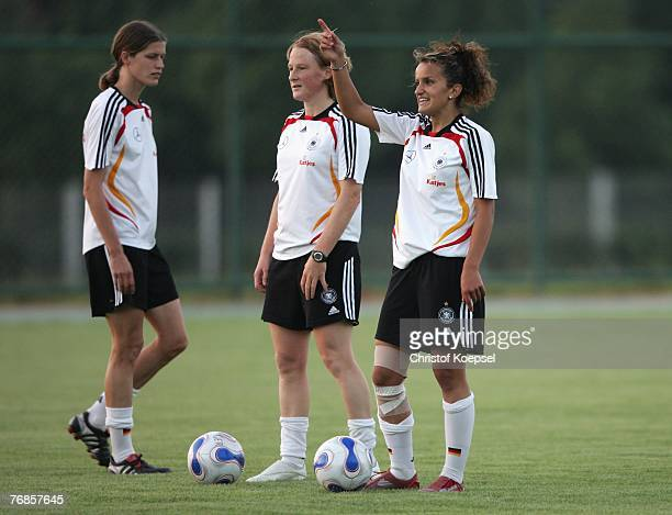 Fatmire Bajramaj issues insturctions during the Women's German National Team training session on the training ground at the Wuhan Sports Center...