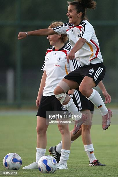 Fatmire Bajramaj jumps up during the Women's German National Team training session on the training ground at the Wuhan Sports Center Stadium on...