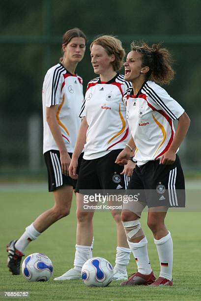 Fatmire Bajramaj laughs during the Women's German National Team training session on the training ground at the Wuhan Sports Center Stadium on...