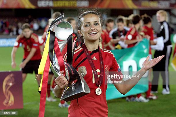 Fatmire Bajramaj of Germany celebrates with the trophy after winning the UEFA Women's Euro 2009 Final match between England and Germany at the...