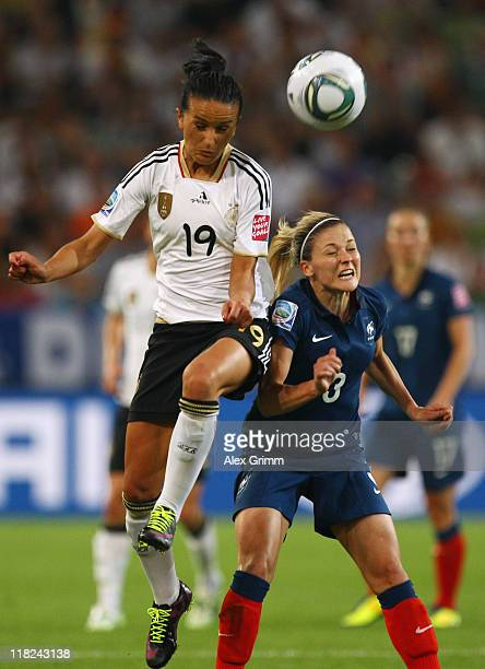 Fatmire Bajramaj of Germany outjumps Laure Boulleau of France during the FIFA Women's World Cup 2011 Group A match between France and Germany at the...