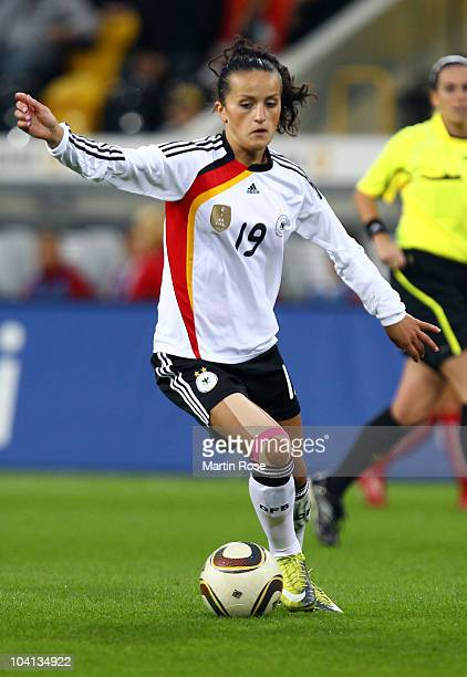 Fatmire Bajramaj of Germany runs with the ball during the Women's International Friendly match between Germnay and Canada at Rudolf Harbig stadium on...