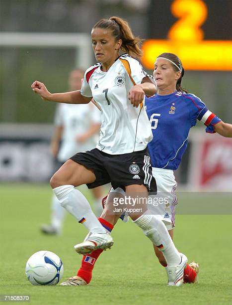 Fatmire Bajramaj of Germany vies for the ball with Caroline Pizzala of France during the Women's U19 Europen Championship match between Germany and...