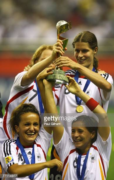 Fatmire Bajramaj Sandra Smisek and Kerstin Garefrekes of Germany celebrate with the trophy at the end of the Women's World Cup 2007 Final between...