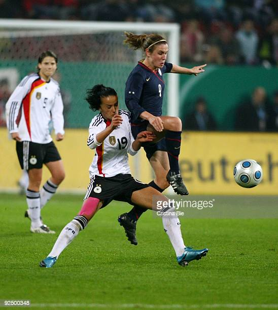 Fatmire Lira Bajramaj of Germany and Heather O'Reilly of USA battle for the ball during the Women's International friendly match between Germany and...