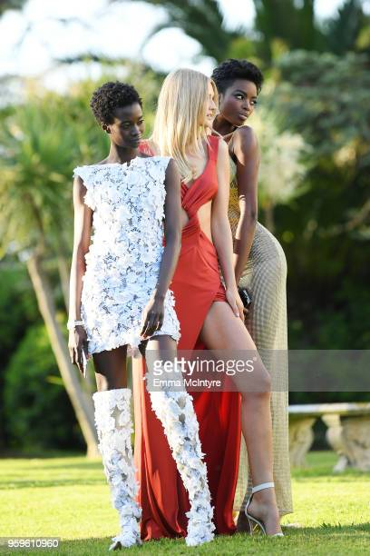 Fatou Jobe Toni Garrn and Maria Borges attend the cocktail at the amfAR Gala Cannes 2018 at Hotel du CapEdenRoc on May 17 2018 in Cap d'Antibes France