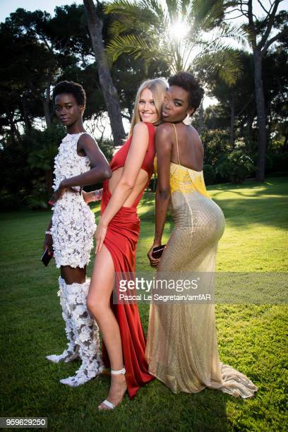 Fatou Jobe Toni Garrn and Maria Borges pose for portraits at the amfAR Gala Cannes 2018 cocktail at Hotel du CapEdenRoc on May 17 2018 in Cap...