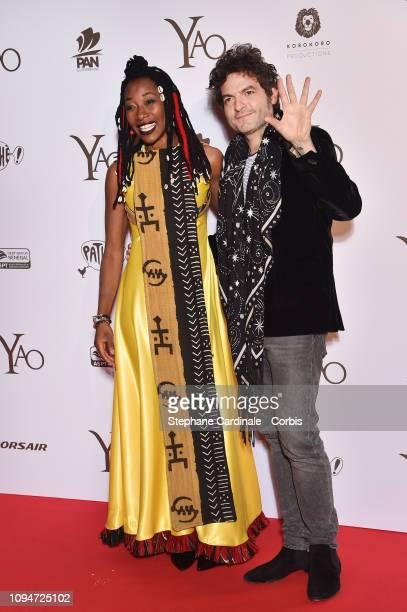 Fatoumata Diawara and Matthieu Chedid aka M attend 'Yao' Paris Premiere at Le Grand Rex on January 15 2019 in Paris France