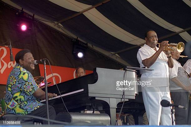 Fats Domino and Dave Bartholomew perform at the New Orleans Jazz & Heritage Festival on April 25, 1999.