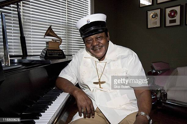 Fats Domino poses after accepting his Grammy Lifetime Achievement Award presented by the Recording Academy's Angelia BibbsSanders at a ceremony to...