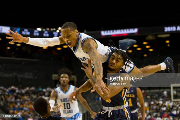 Fatts Russell of the Rhode Island Rams goes up for a shot against Pookie Powell of the La Salle Explorers during the second round of the Atlantic 10...