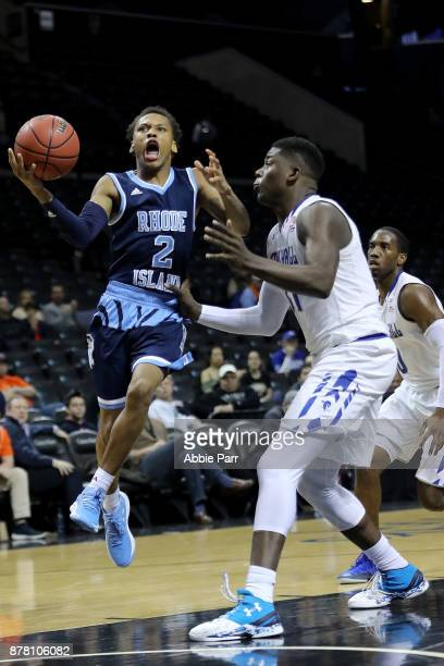 Fatts Russell of the Rhode Island Rams takes a shot against Angel Delgado of the Seton Hall Pirates in the second half during their game at Barclays...