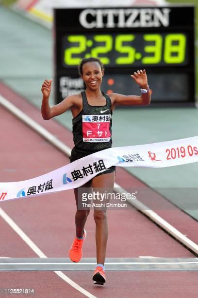 Fatuma Sado of Ethiopia crosses the finish tape to win the 38th Osaka Women's Marathon at Yanmar Stadium Nagai on January 27, 2019 in Osaka, Japan.