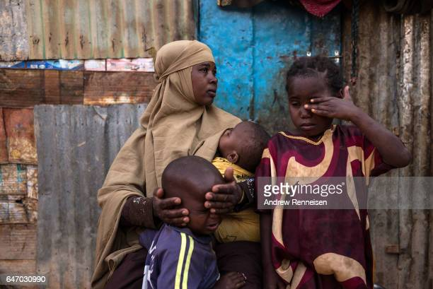Fatun Mohamed Sareye sits at her home with her family at the Shabelle IDP camp on February 26 2017 in Garowe Somalia Sareye lost both her husband and...