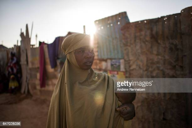 Fatun Mohamed Sareye walks outside her home at the Shabelle IDP camp on February 26 2017 in Garowe Somalia Sareye lost both her husband and her...