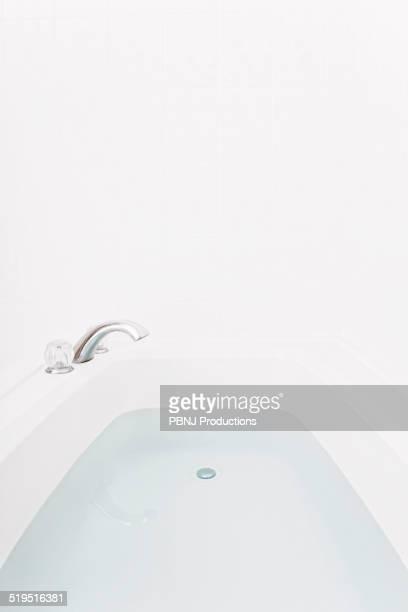 Faucet over full bathtub
