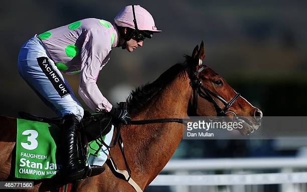Faugheen ridden by Ruby Walsh race during The Stan James Champion Hurdle Challenge Trophy during Day One of the Cheltenham Festival at Cheltenham...