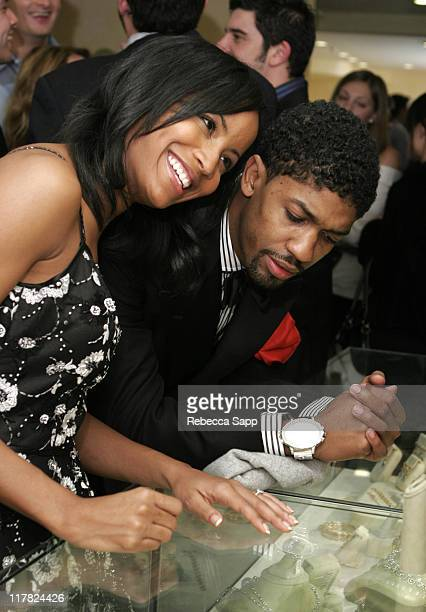 Faune Chambers and Fonzworth Bentley look at Erica Courtney jewelry
