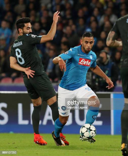 Fauozi Ghoulam of Napoli competes for the ball with Ilkay Gundogan of Manchester City during the UEFA Champions League group F match between SSC...