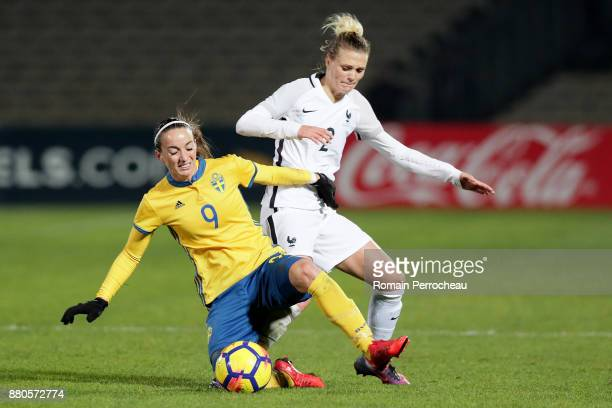 Faustine Robert of France and Kosovare Asllani in action during a Women's International Friendly match between France and Sweden at Stade...