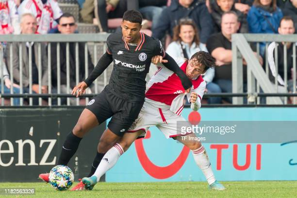 Faustino Anjorin of FC Chelsea U19 and Filip Frei of Ajax Amsterdam U19 battle for the ball during the UEFA Youth League match between AFC Ajax and...