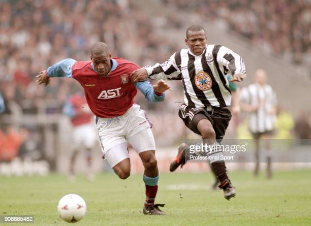 Faustino Asprilla of Newcastle United and Ugo Ehiogu of Aston Villa in action during the FA Carling Premiership match at St James' Park on April 14...