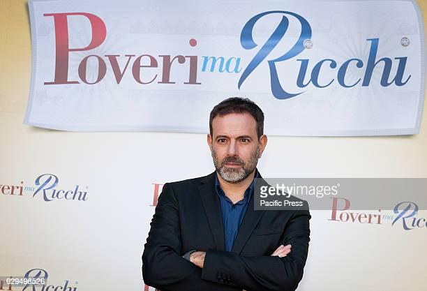 """Fausto Brizzi attend a photocall for his film """"Poveri ma Ricchi""""."""