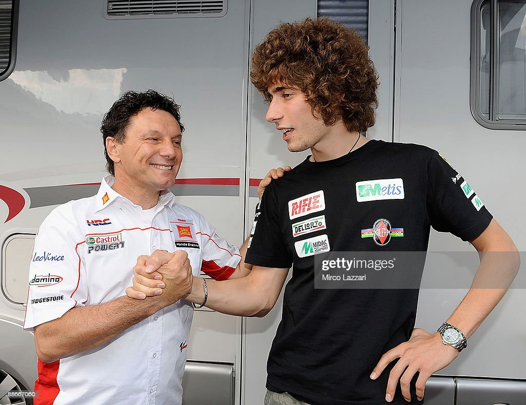 Fausto Gresini of Italy and San Carlo Honda Gresini jockes with Marco...  News Photo - Getty Images