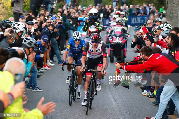 Fausto Masnada of Italy and Team Deceuninck - Quick-Step and Tadej Pogacar of Slovenia and UAE Team Emirates compete in the breakaway while fans...