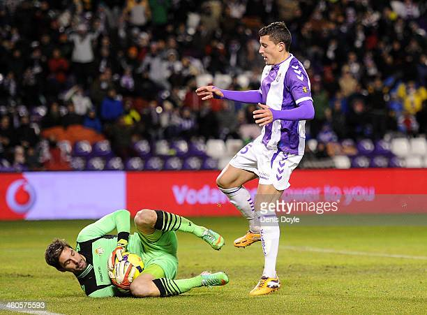 Fausto Rossi of Real Valladolid CF is tackled by Guilermo Sara of Real Betis Balompie during the La Liga match between Real Valladolid CF and Real...