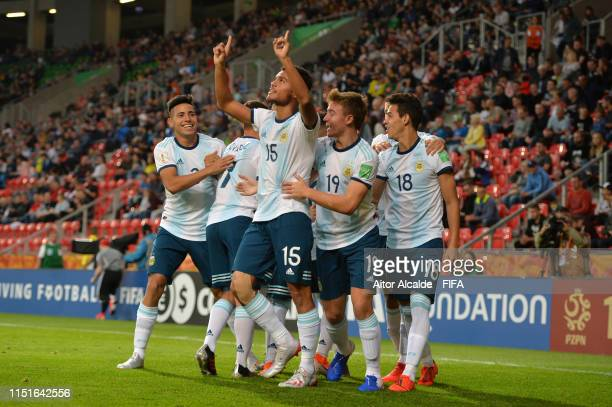 Fausto Vera of Argentina celebrates with teammates after scoring his team's first goal during the 2019 FIFA U20 World Cup group F match between...