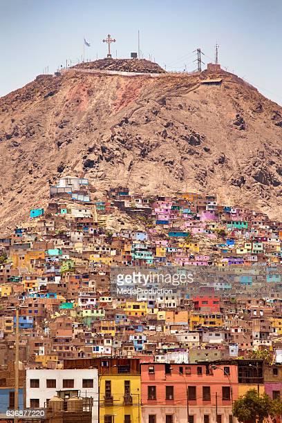 favelas of lima peru - lima peru stock photos and pictures