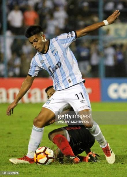 Favio Alvarez of Argentinian Atletico Tucuman disputes the ball with Antonio Bareiro of Paraguayan Libertad during a 2018 Libertadores Cup football...